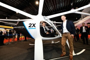 """Mr Baey Yam Keng, Senior Parliamentary Secretary, Ministry of Transport, and Mr Florian Reuter, CEO, Volocopter, with the Volocopter 2X aircraft, which made its Asia debut at Rotorcraft Asia 2019 and Unmanned Systems Asia 2019."""