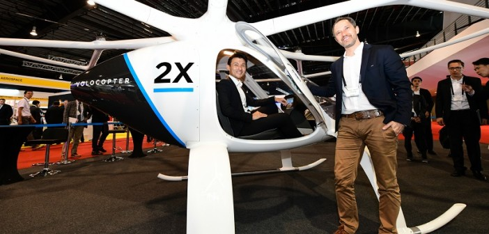 Mr Baey Yam Keng, Senior Parliamentary Secretary, Ministry of Transport, and Mr Florian Reuter, CEO, Volocopter, with the Volocopter 2X aircraft 1